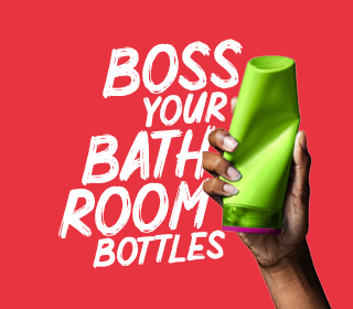 Hand holding a shampoo bottle with slogan Boss your bathroom bottles